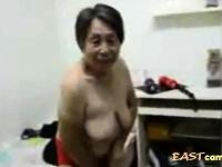 Asian Grandma get dressed after sex