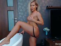 Amateur blonde busty babe camgirl posing on webcam