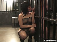 Being behind the bars Japanese slut Kana Mimura sucks a strong boner cock