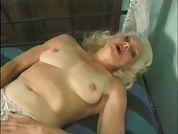 Mature auburn whore masturbates her wet old pussy with a toy