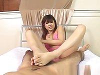 Rika Hayama in pink lingerie strokes penis